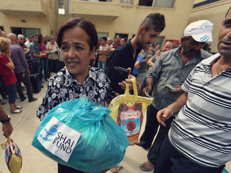 Iraqi refugees receiving aid from Shai Fund
