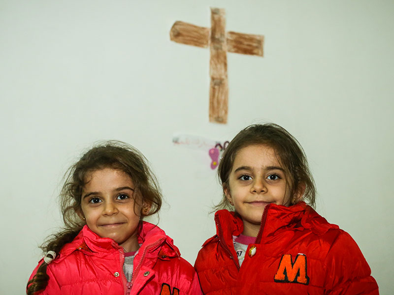 Young Iraqi girls with new winter jackets