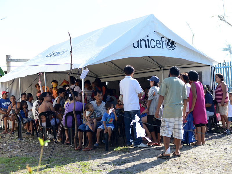 Waiting for aid under the UNICEF tent