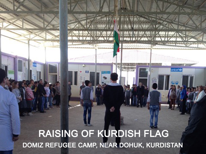 Raising Kurdish flag