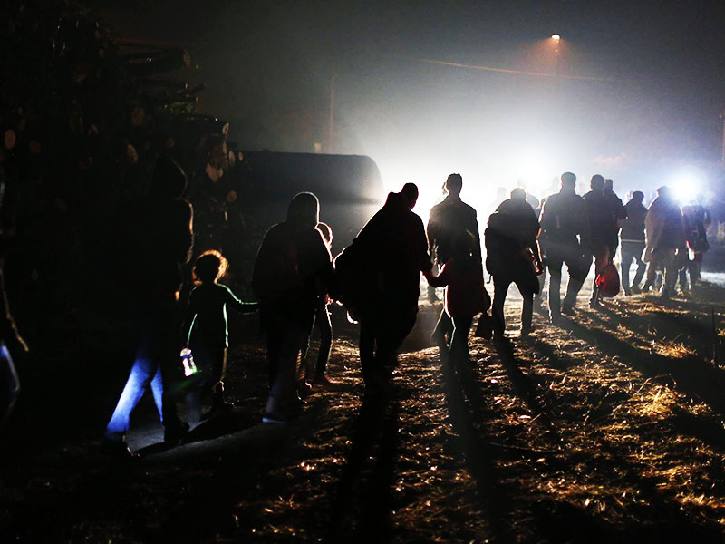 Syrian refugees arriving at night