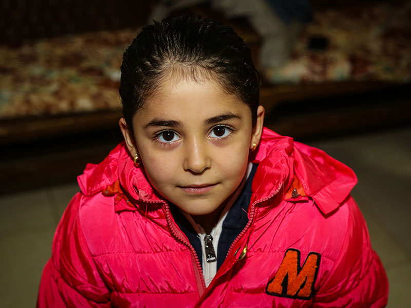 Young Iraqi girl with new winter jacket from Shai Fund